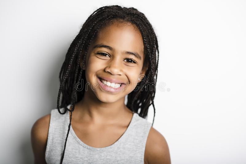 Adorable african little girl on studio gray background stock image