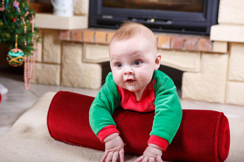 Adorable baby boy with christmas decoration. royalty free stock photography