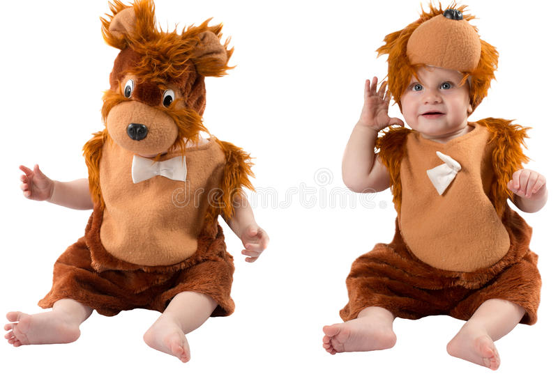 Adorable baby boy,dressed in furry teddy bear carnival suit, isolated on white background. royalty free stock photo