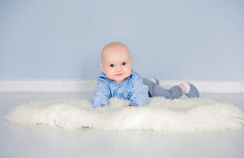 Adorable baby boy laying on the floor in her nursery under the tent. Photo of Adorable baby boy laying on the floor in her nursery under the tent royalty free stock photography