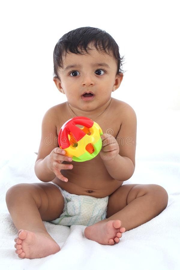 Adorable baby boy playing with ball royalty free stock photography