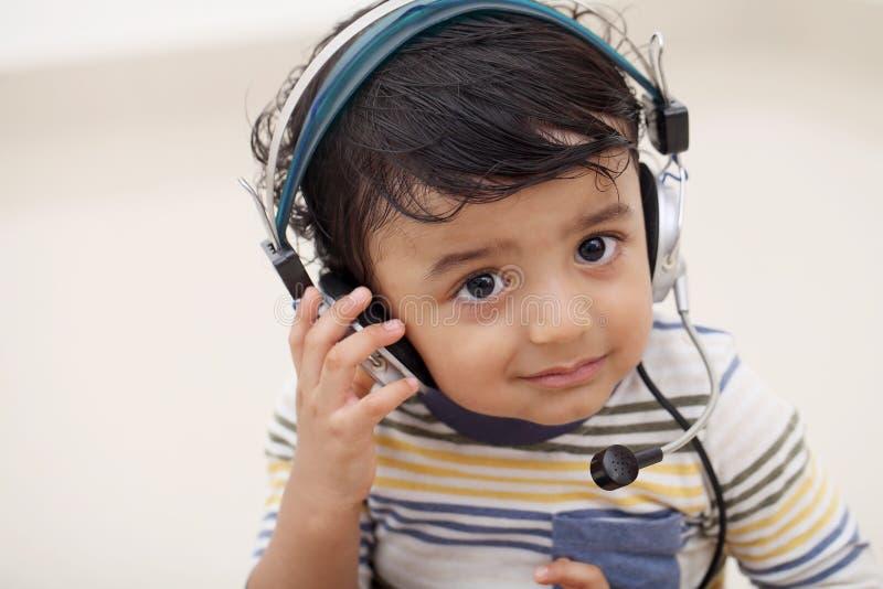 Adorable baby boy talking on microphone stock photos