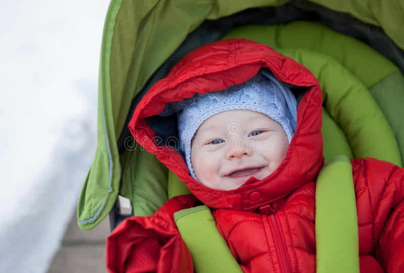 Adorable baby boy in winter jacket royalty free stock image