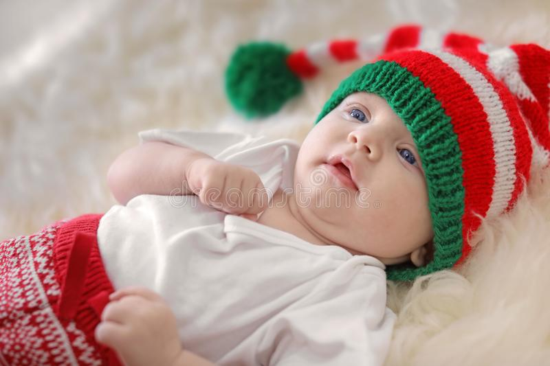 Adorable baby in Christmas hat stock photos