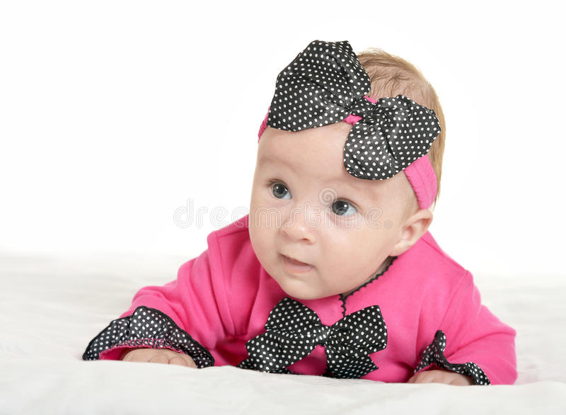 Adorable baby girl on blanket. In cute pink clothes on a white background royalty free stock photos