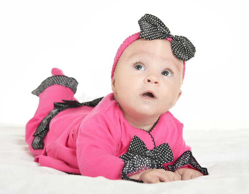 Adorable baby girl on blanket. In cute pink clothes on a white background royalty free stock images