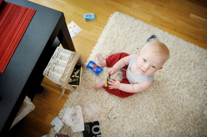 Adorable baby girl making a mess stock image