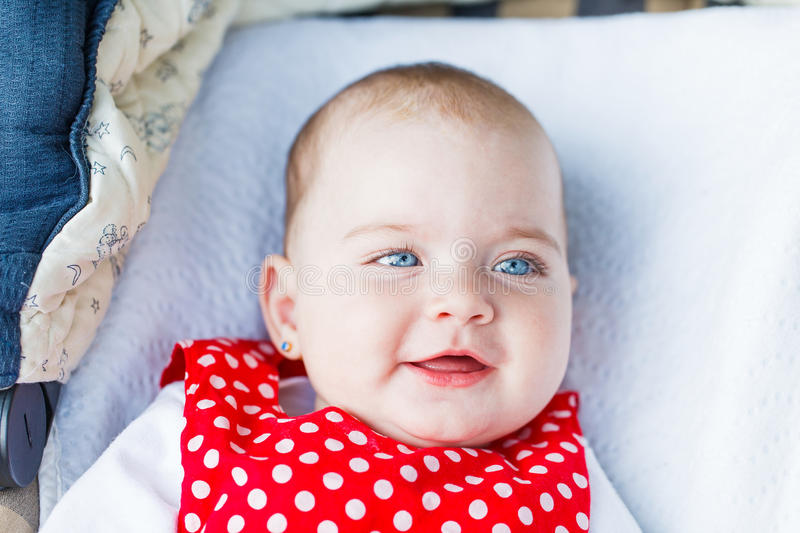Adorable baby girl. Portrait photo of blue eyed adorable baby girl stock photo