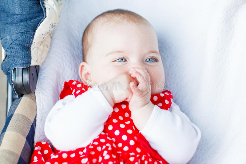 Adorable baby girl. Portrait photo of blue eyed adorable baby girl royalty free stock image