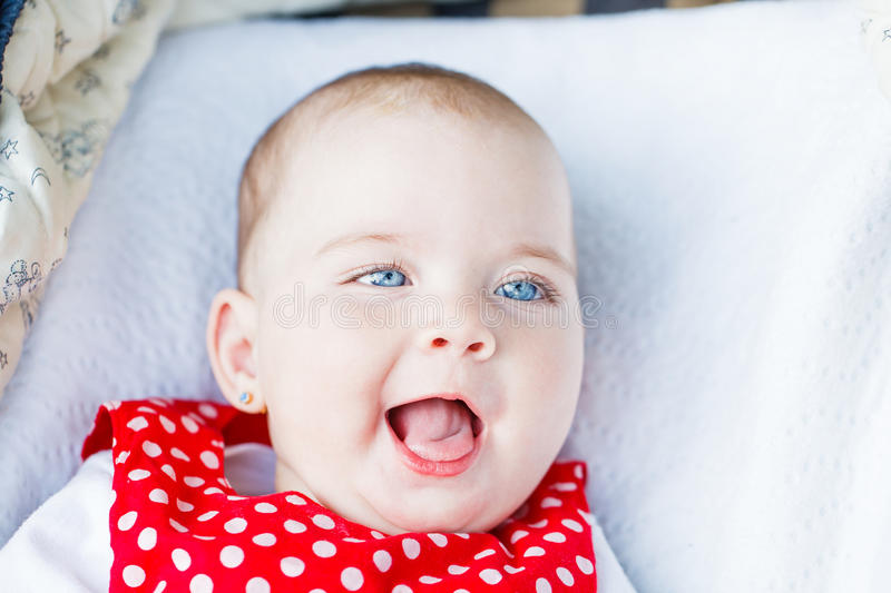 Adorable baby girl. Portrait photo of blue eyed adorable baby girl stock images
