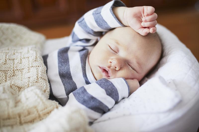 Adorable baby girl sleeping in the crib. Little child having a day nap in cot. Infant kid resting in nursery stock images