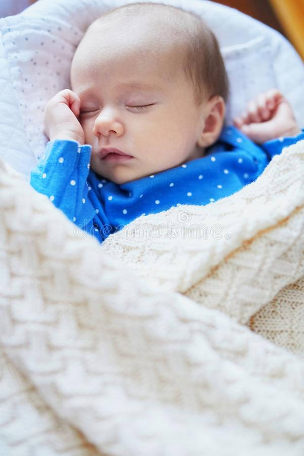 Adorable baby girl sleeping in the crib. Little child having a day nap in cot. Infant kid resting in nursery royalty free stock image
