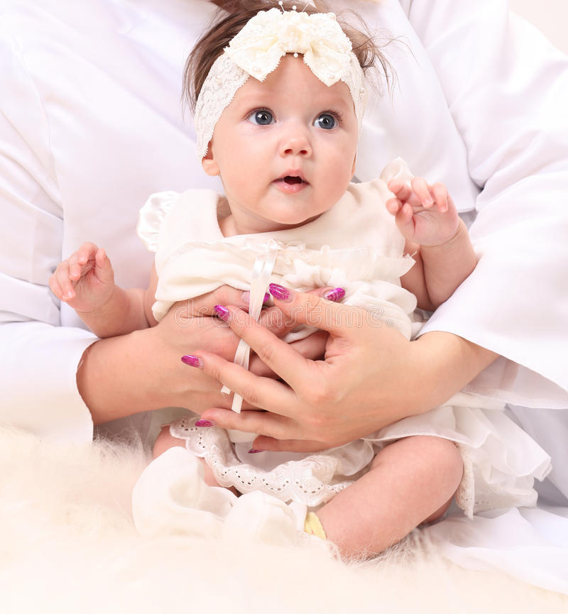 Adorable baby girl in white dress royalty free stock photography
