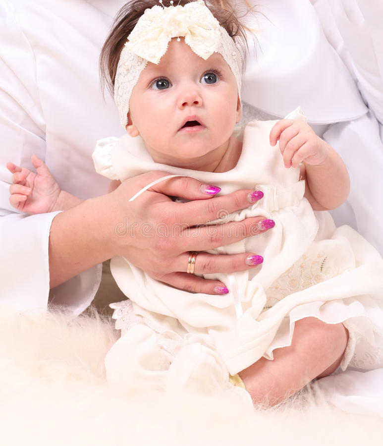 Adorable baby girl in white dress royalty free stock photo