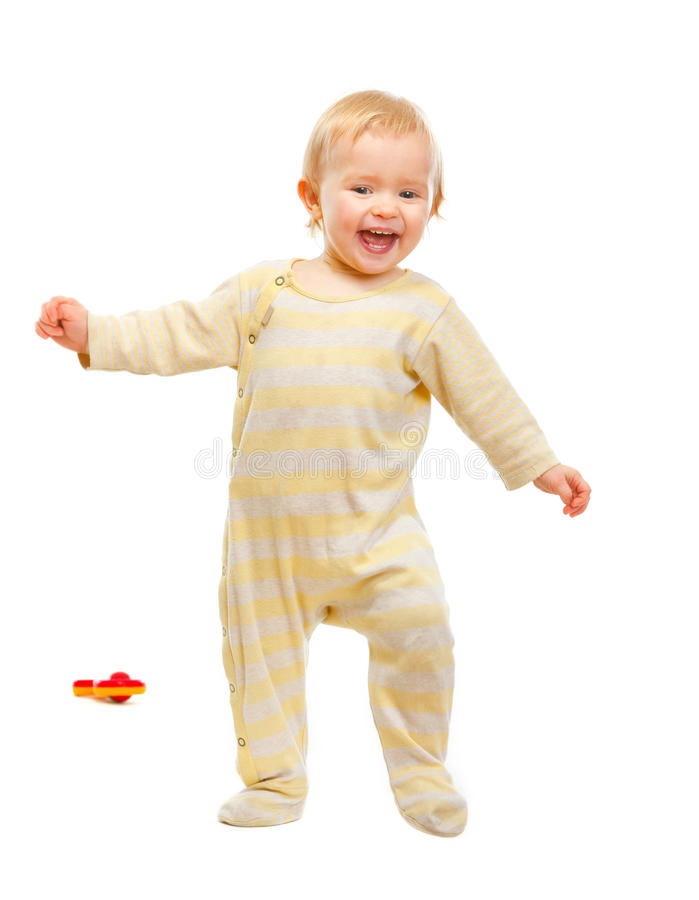 Adorable baby having fun on white background