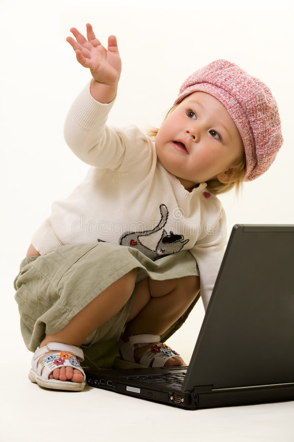 Adorable baby with laptop royalty free stock image