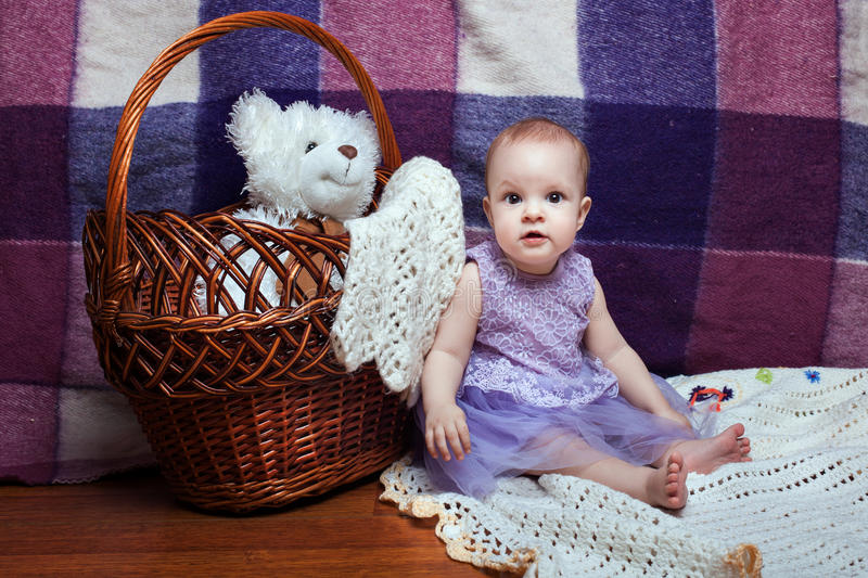 Adorable baby near wicker basket royalty free stock image