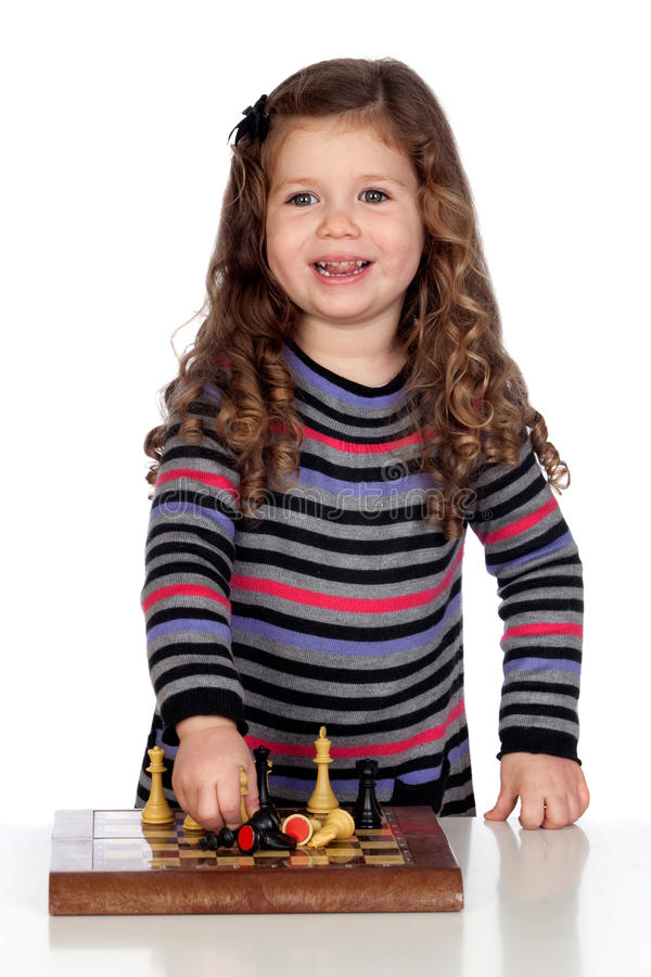 Adorable baby playing chess