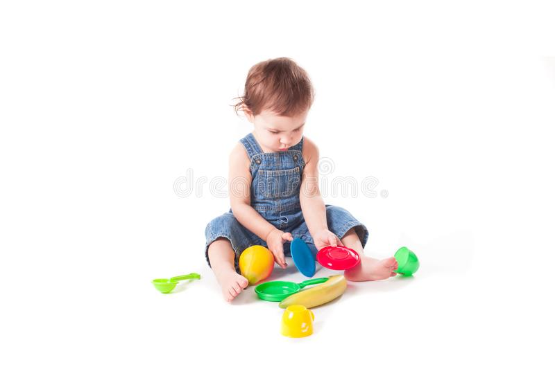 Adorable baby playing with colorful toys stock photography