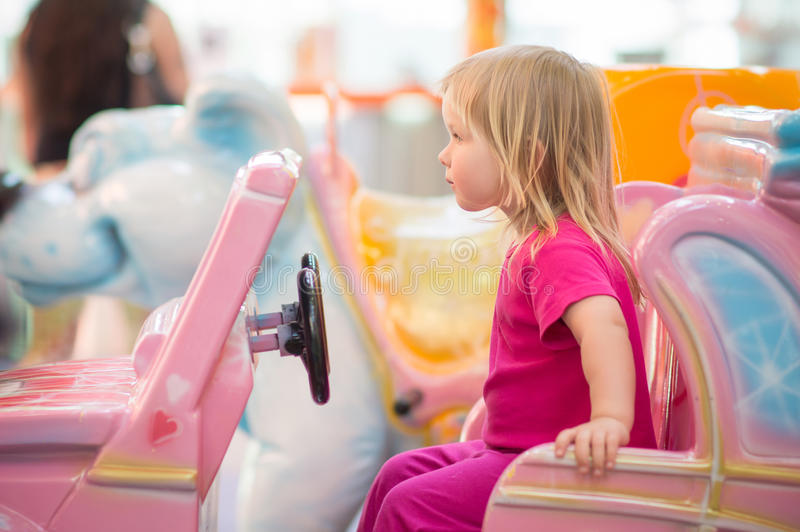 Download Adorable Baby Ride On Toy Car In Mall Royalty Free Stock Photo - Image: 24838985