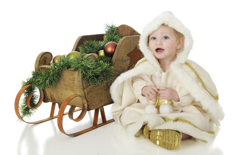 Happy Snow Princess with Her Sleigh stock photos