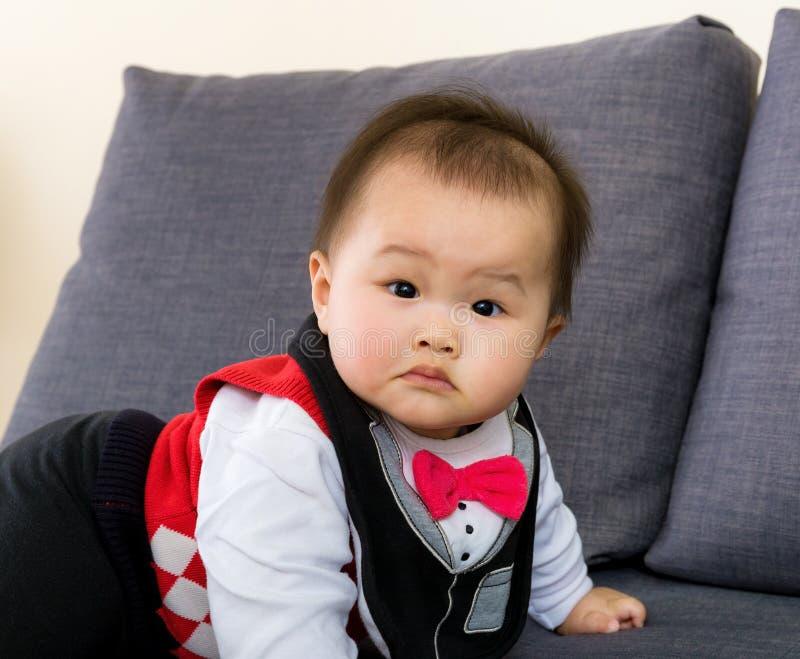 Adorable baby on sofa stock photo
