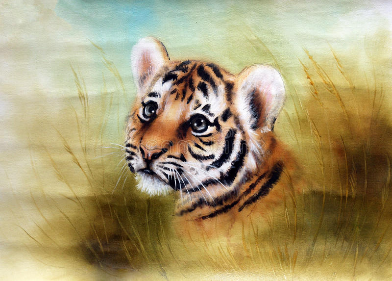 Adorable baby tiger head looking out from a green grass surround. A beautiful airbrush painting of an adorable baby tiger head looking out from a green grass royalty free illustration