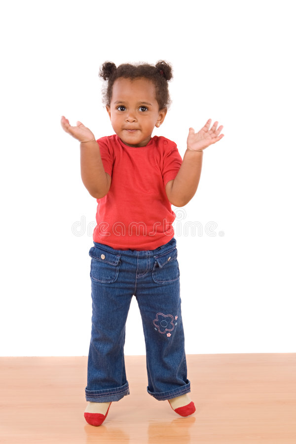 Adorable and beautiful african baby jumping royalty free stock photo