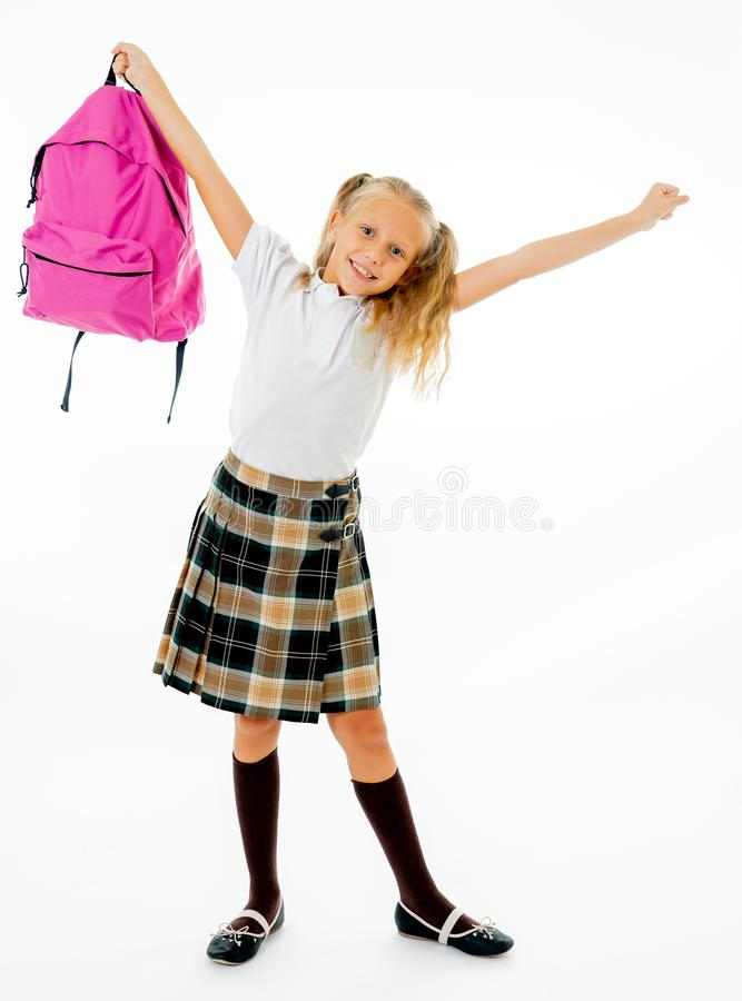 Adorable beautiful little schoolgirl with big pink schoolbag feeling excited and happy being back to school isolated on white royalty free stock photos