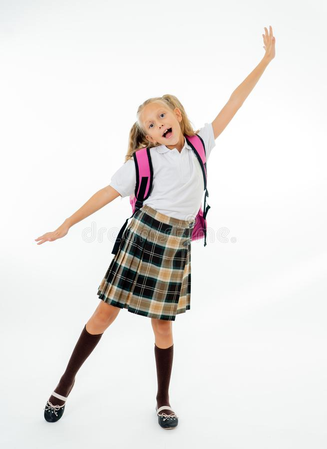 Adorable beautiful little schoolgirl with big pink schoolbag feeling excited and happy being back to school isolated on white stock photos