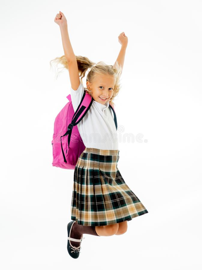 Adorable beautiful little schoolgirl with big pink schoolbag feeling excited and happy being back to school isolated on white royalty free stock photo