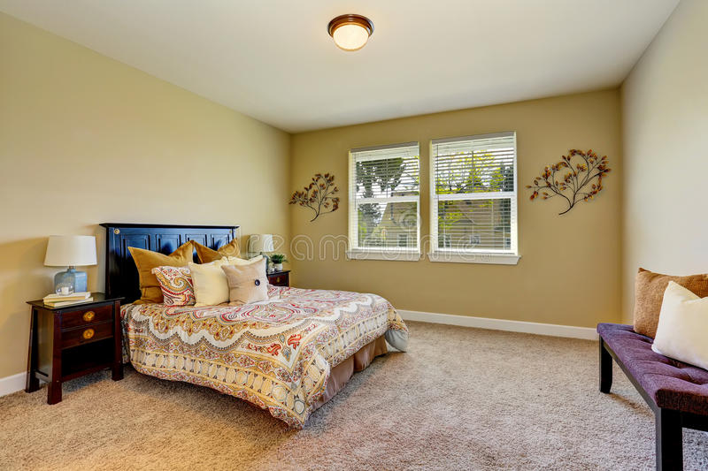 Adorable bedroom interior with beige walls, wooden furniture. And carpet floor. Northwest, USA stock photo
