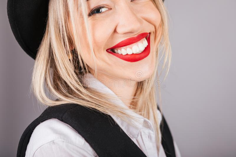 Adorable big teeth smile. Beautiful woman close up portrait. Black and white clothes grey background royalty free stock photos