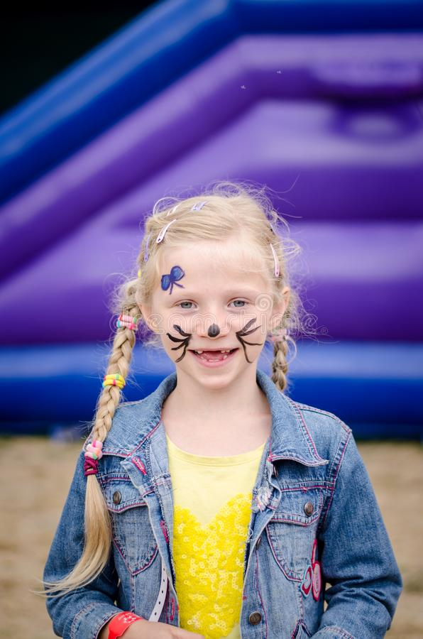Little lovely child with face painting smiling royalty free stock photo