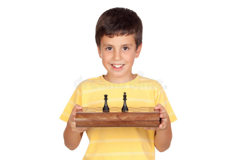 Adorable boy with chessboard stock image