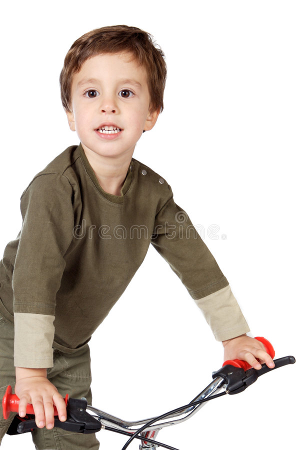 Adorable boy cycling stock photo