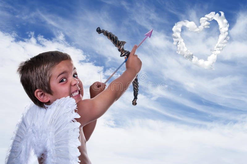 Adorable boy dressed as Cupid royalty free stock photo