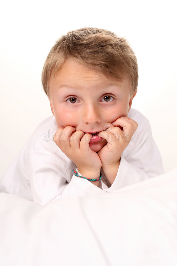 Adorable boy making silly face royalty free stock image