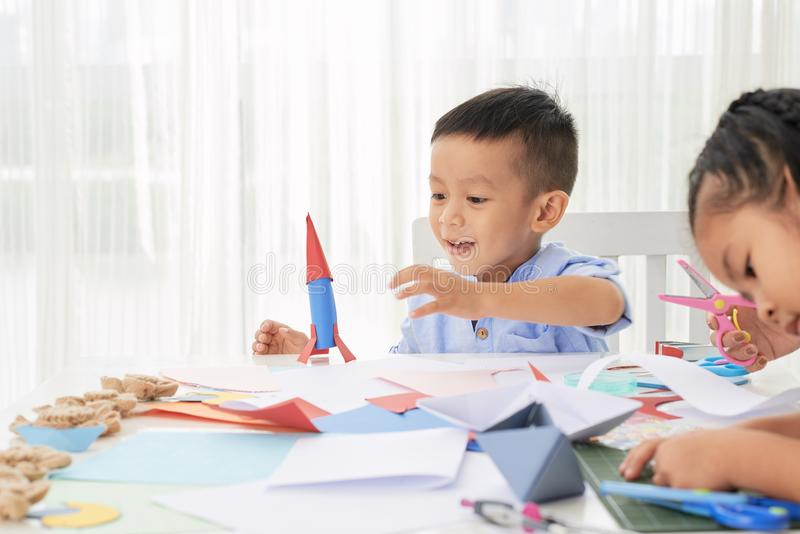 Adorable boy with paper rocket royalty free stock photos