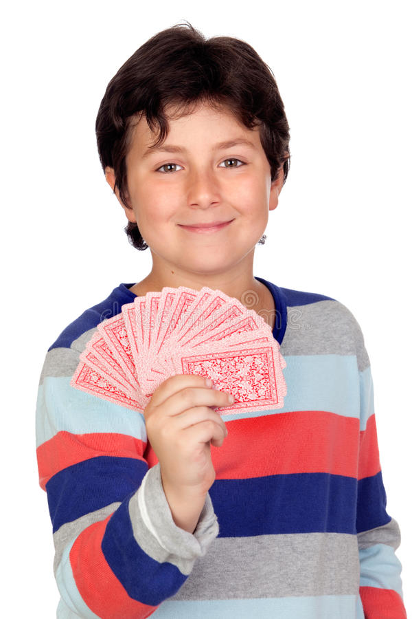 Adorable boy playing cards royalty free stock images