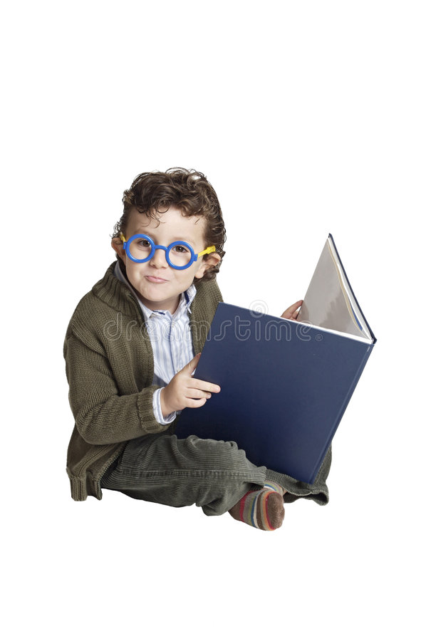 Adorable boy reading a book stock photos