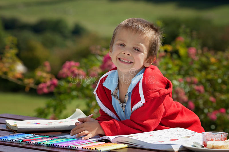 Adorable Boy In Red Sweater, Drawing A Painting In A Book, In Th ...