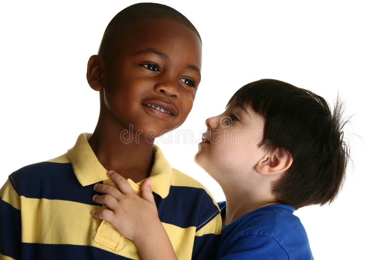 Adorable Boys Telling Secrets. Adorable 5 year old African American boy against white background listening to friend tell secrets royalty free stock photography