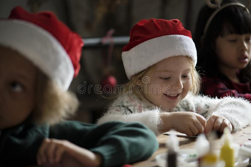 Adorable cheerful little girl wearing a santa hat royalty free stock photo