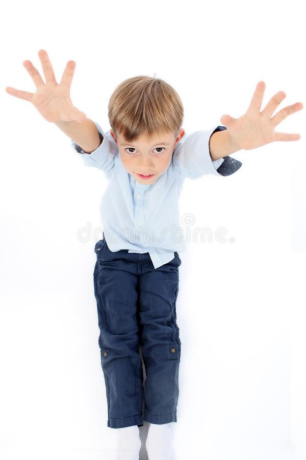 Adorable child boy reaching hands towards you stock images