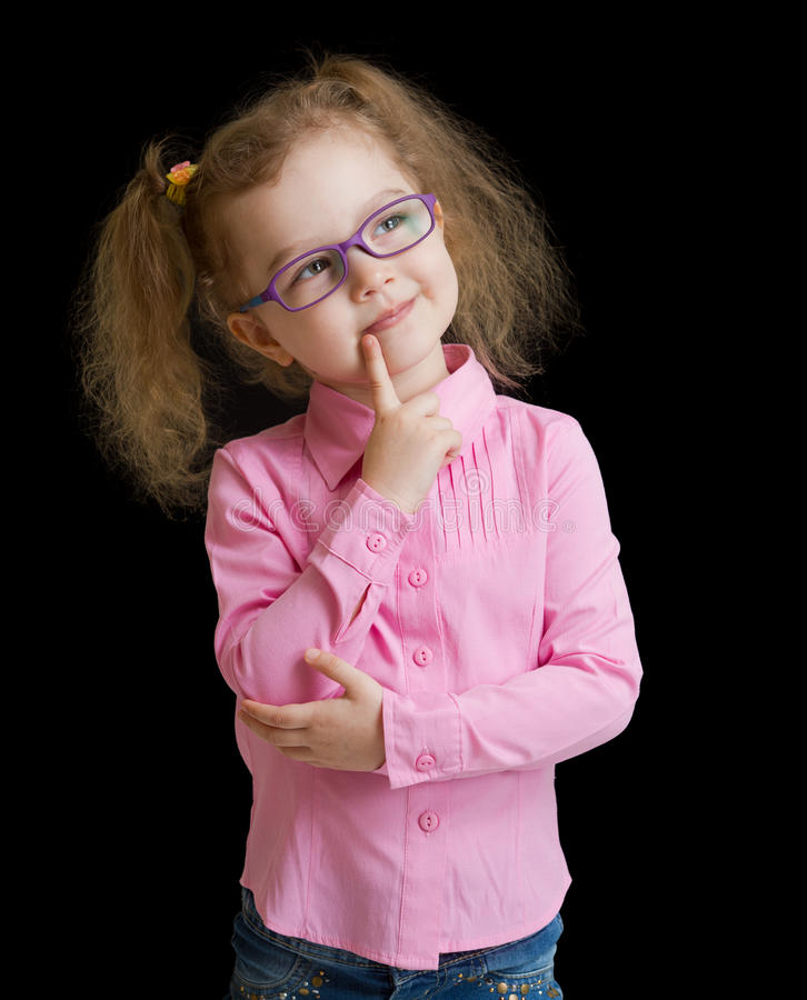 Adorable child girl in eyeglasses isolated on black stock image