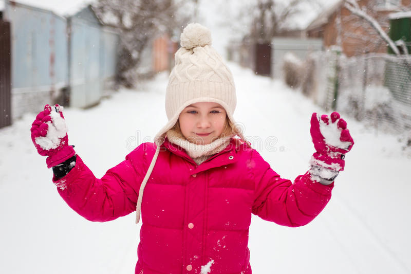 Adorable child girl playing outdoor with snow stock photography