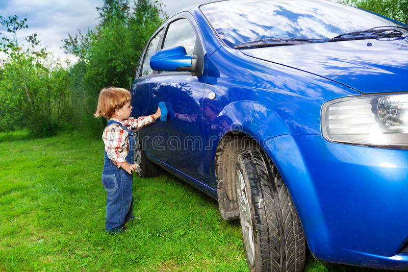 Download Adorable Child Helping To Wash Car Stock Photo - Image of passion, blue: 26319358