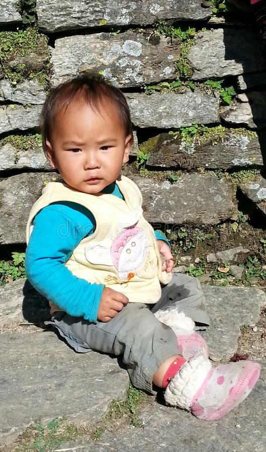 Adorable child of Nepal villager stock images