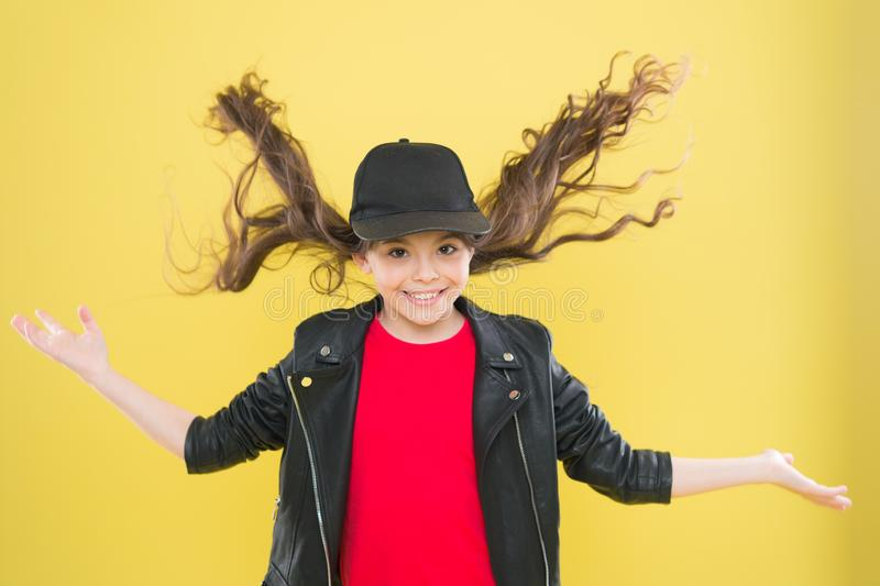 Adorable child nice hairstyle. Happy childhood. Small girl with long curly hair. Hairdresser salon. Having fun. Hairstyle diy. Girl long curls. Fashion trend royalty free stock photo